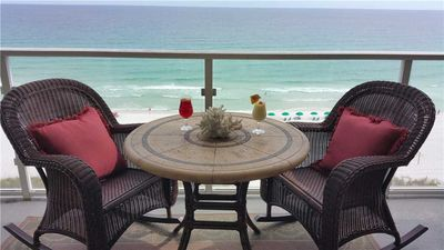Photo for Beachy Style Retreat That Features Updated Kitchen And Lush Patio Furnishings Beach front Balcony!