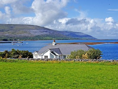 Photo for Semi-detached cottage in fine location beside the sea with far reaching views over Galway Bay…