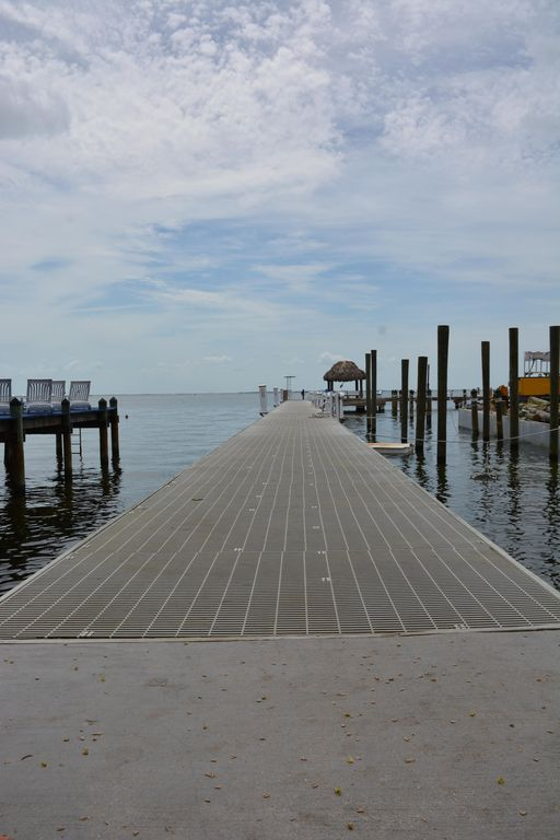 NEW LISTING! Stunning Views w/ Private Boat Slip. Newly Refreshed. Clean!