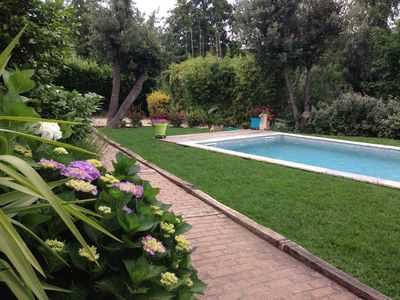 Photo for Very nice air-conditioned apartment with heated pool in charming villa.