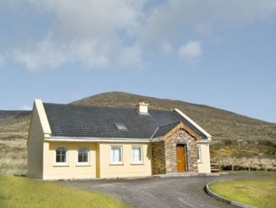 A comfortable cottage set on a small hill with a view of the Glen