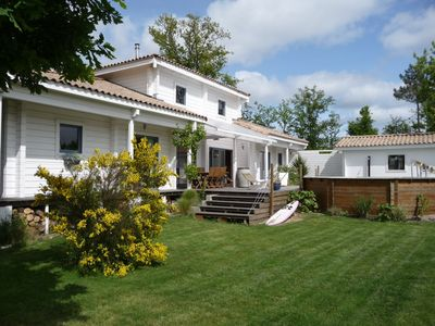 Photo for contemporary villa wooden large volume, heated pool, 4km beach, 2 to 10 pers