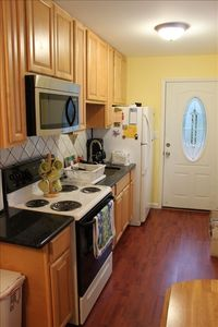 New modern kitchen with granite counter tops, fully equiped.