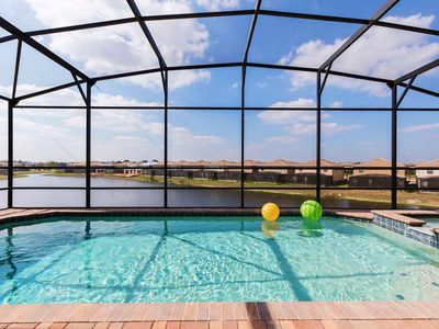 Photo for New 9Br/6Ba luxurious Pool House with lake view from $280/nt, Close To Disney