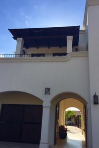 The front view from the street of the Villa casita and breezeway entrance.
