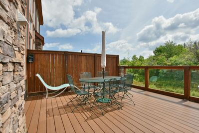 top deck with hot tub and barbecue