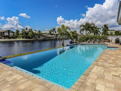 Photo for Infinity Edge 50 Ft Pool Home on Deep Water Canal Fully Remodeled