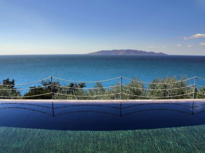Photo for Stunning sea-front villa with infinity pool and access to private beach club