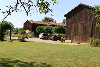 Entrance showing the car park and the two tobacco drying barns (Séchoirs)