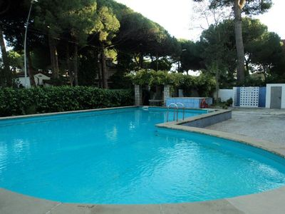 Photo for Apartment located in residential area with terrace, swimming pool and garden areas