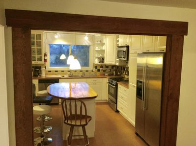 Eat in kitchen with stainless steel appliances, wood countertops and cork floori