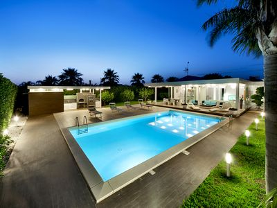 Photo for Beautiful villa in a modern style, with swimming pool, solarium and garden.