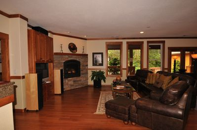 Living room with large screen TV, surround sound & DirecTV