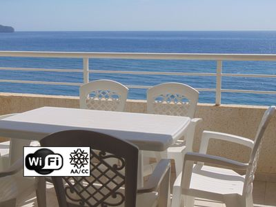 Photo for Apartment with pool and sea view 50 meters from the beach