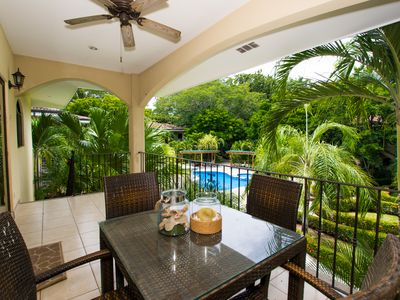 Photo for Gorgeous condo with beautiful pool area and steps from prestine beach
