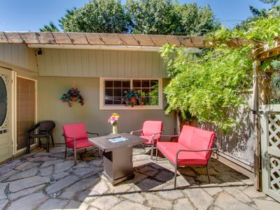 Photo for Dog-friendly cottage w/ a private hot tub, a huge backyard, walk to the beach!