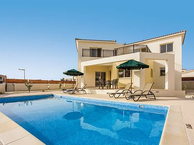 Photo for A modern villa with no need to hire a car - walk to the beach & array of popular resort facilities