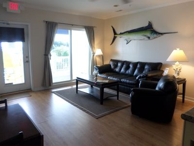 Photo for Waterfront condo, walking distance to shopping and dining