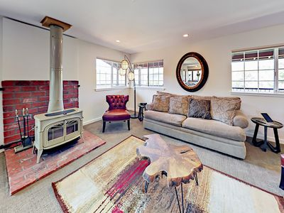 Living Room - Unwind on a queen-size sleeper sofa and 2 leather chairs in the living room. (Please note the fireplace is not operational)
