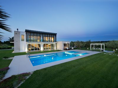 Photo for Modern villa with swimming pool surrounded by greenery