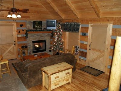 Mountain tree with white lights, 48 Flat Screen TV above Fireplace