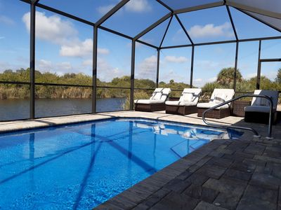 Photo for Stunning BRAND NEW 3 bed home, fabulous pool overlooking river, free wifi, bikes, BBQ. Nr Beaches, shops, restaurants and GOLF