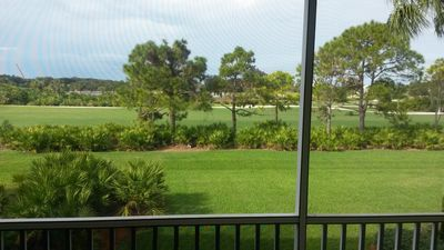Screened balcony with golf course view