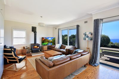 Living room with knockout views, large TV and woodfire.