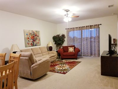 comfortable living room, reclining couch, smart Tv