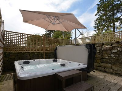 Indulge in the hot tub, straight off the bedroom, in the private garden