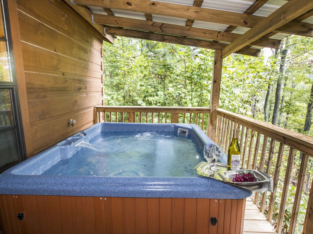 Hot springs log cabins nc tub fireplace grill