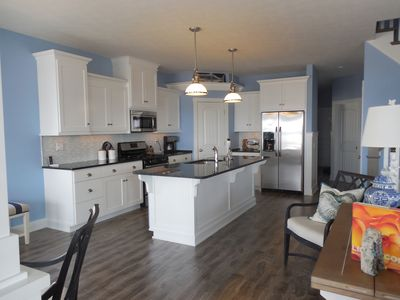 Large Kitchen Area with Granite Counter Top Island and Custom Cabinets