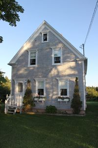 Photo for Beachfront Solitude in an Updated Farmhouse on 17 Acres!