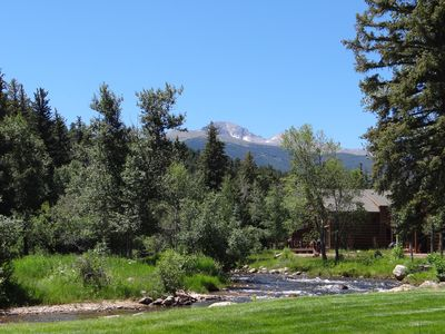 View from backyard, deck, and living room looking up river at Longs Peak