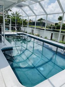 Photo for Beautiful Waterfront Home with Pool walking distance to beach