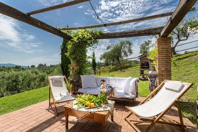 The Outdoor Living and Dining Area - Lucca Rental Villa with Heated Pool