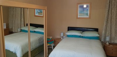 Double bed in the triple room with plenty of storage.