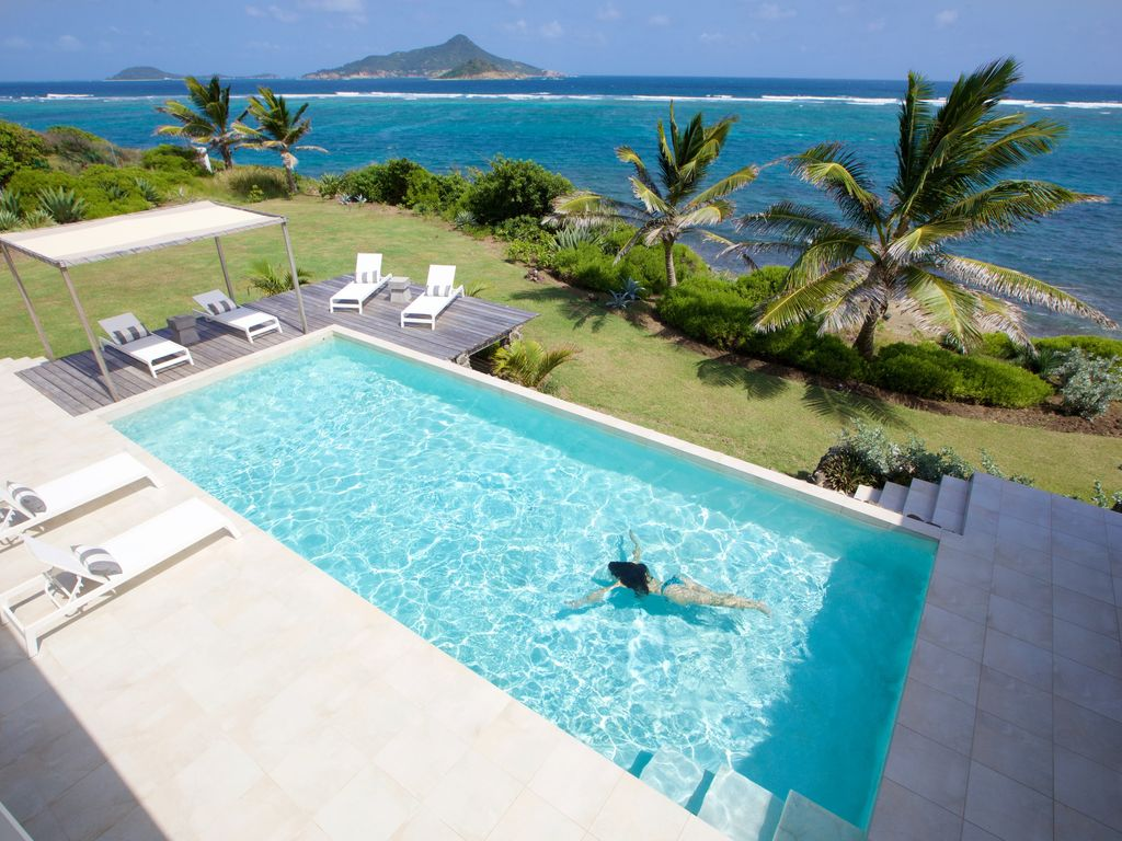 luxury caribbean villa on the sea in unspoilt and friendly island