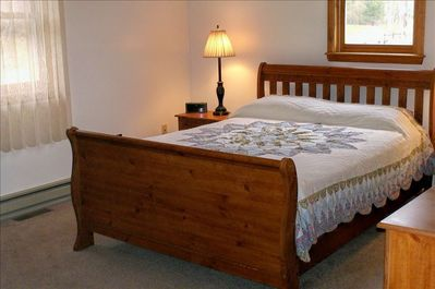 Nicely furnished bedroom (main floor) with queen bed