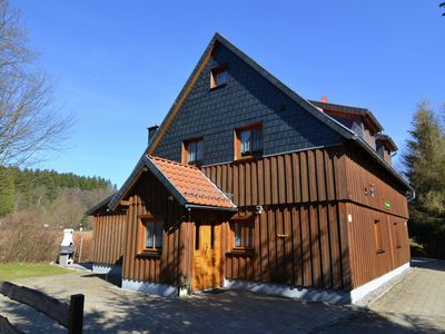 Photo for Holiday home in a quiet setting in the Upper Harz, featuring an open fireplace and sauna