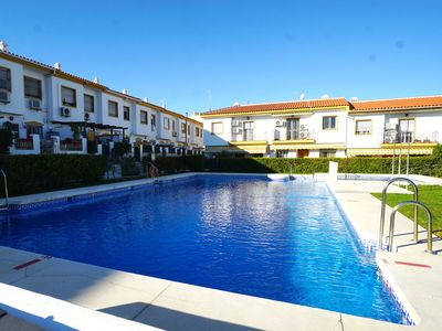 Photo for Terraced house for families with communal pool, close to the town