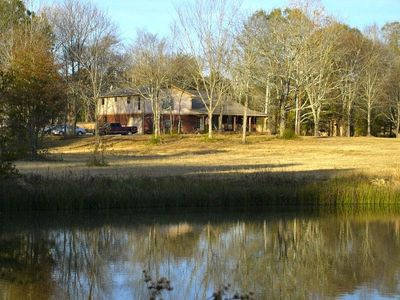 View of the house from the fishing pond.