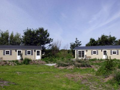 Photo for Cosy chalet, located in a large park on Texel with many facilities.