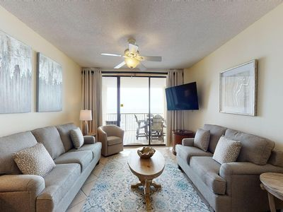 Photo for Waterfront condo w/ expansive balcony, shared pools, hot tub, & beach access