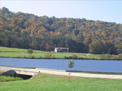 View of the lodge across the 17 acre lake.  Backed up by 120 acres of hiking.