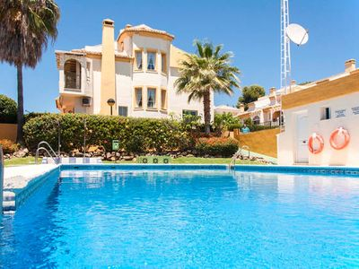 Photo for Very well maintained townhouse with pool, terrace and 100 m from the beach