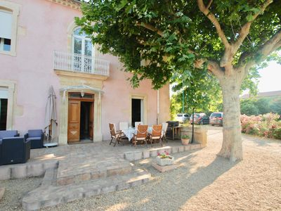 Photo for Between Nîmes and the Sea, beautiful stone house, swimming pool, enclosed garden; car park