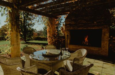 Wisteria lodge | outdoor oversized fireplace | BBQ | dinning table seats 6