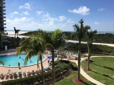 View from balcony overlooking pool and gulf of Mexico.