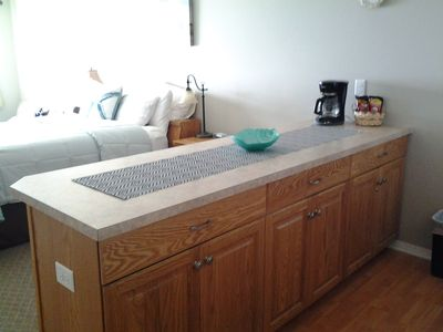 Kitchen Island, eat or serve from.  You can watch the Ocean.